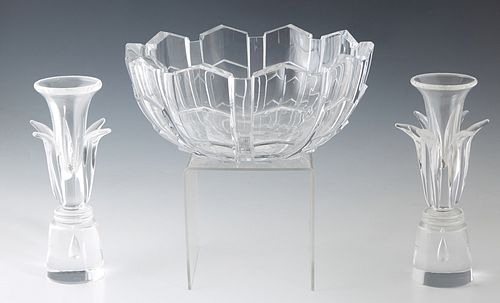 Three Crystal Pieces, consisting of a pair of Steuben candlesticks, 20th c., designed by Donald Pollard in 1962, each having a floriform shaped body,