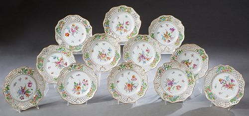 Set of Twelve Dresden Reticulated Porcelain Plates, 20th c., with scalloped edges and gilt and floral decoration, retailed by Bailey, Banks and Biddle