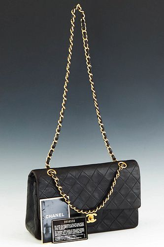 Classic Double Flap Chanel Shoulder Bag, in black quilted lambskin calf leather with gold hardware, opening to a maroon leather lined interior, accomp
