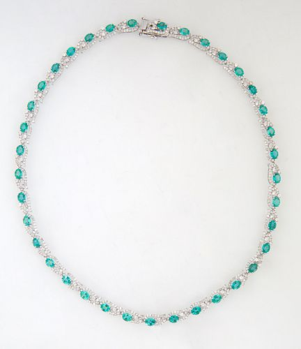 14K White Gold Link Necklace, each of the thirty-seven oval links with a graduated oval emerald within an oval swirled border of round diamonds, total