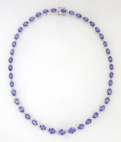 14K White Gold Link Necklace, each of the forty-one oval links with a graduated oval tanzanite atop a border of tiny round white diamonds, total tanza
