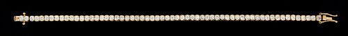 14K Yellow Gold Tennis Bracelet, each of the sixty links with a graduated bezel set round diamond, total diamond wt.- 4.8 cts., L.- 7 in., with apprai