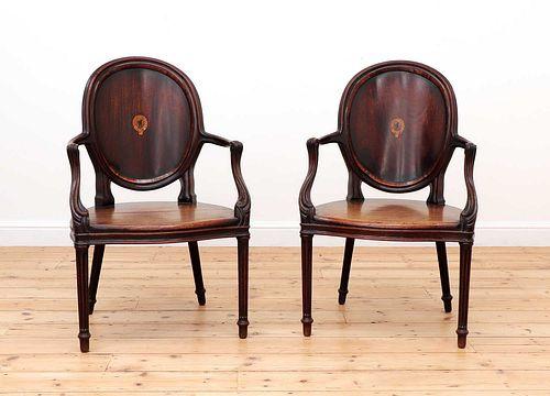 A pair of mahogany hall chairs,