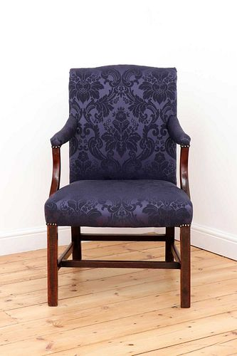 A George III mahogany Gainsborough armchair,