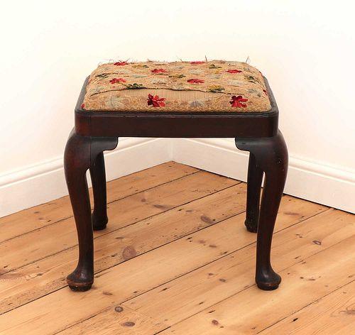 A George III mahogany stool,