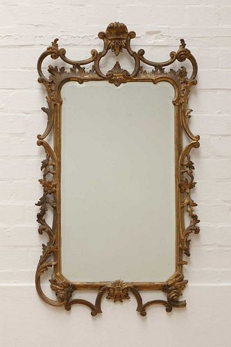 A George III-style carved giltwood wall mirror,