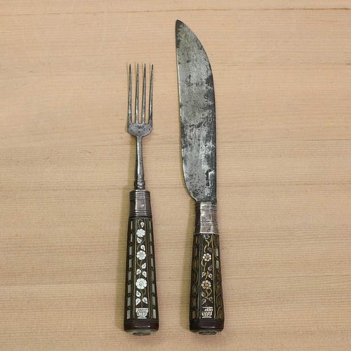 A steel knife and fork,
