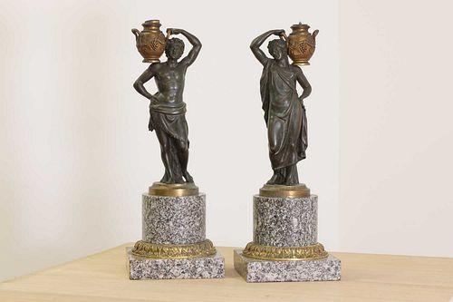 A pair of bronze figural candlesticks,