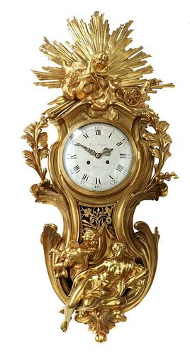 A large Louis XVI-style gilt-bronze cartel clock,