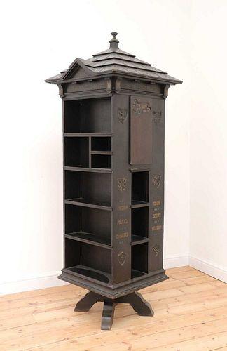 An American 'Tabard Inn Library' ebonised oak revolving bookcase,