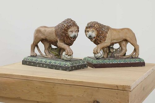 A pair of large pearlware lions,
