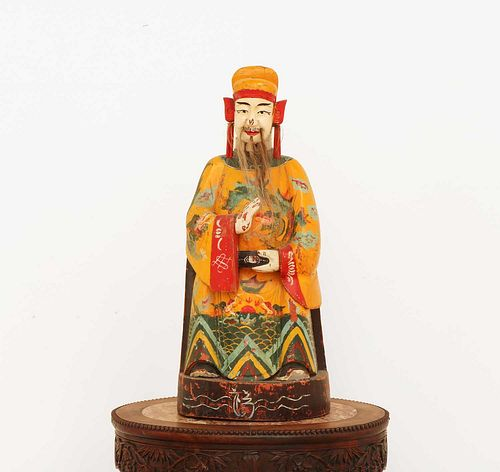 A Chinese polychrome painted wooden house god or attendant,