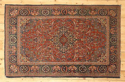 A Persian wool rug,