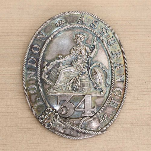 A George IV silver London Assurance fireman's badge,