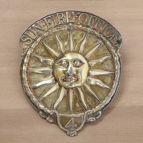 A George III silver gilt Sun Fire Office fireman's arm badge,