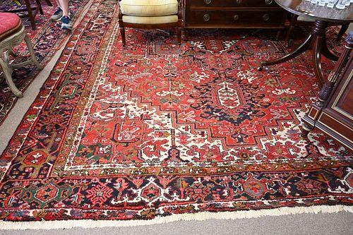 "Heriz Oriental Carpet, 11' 2"" x 16' 10""."