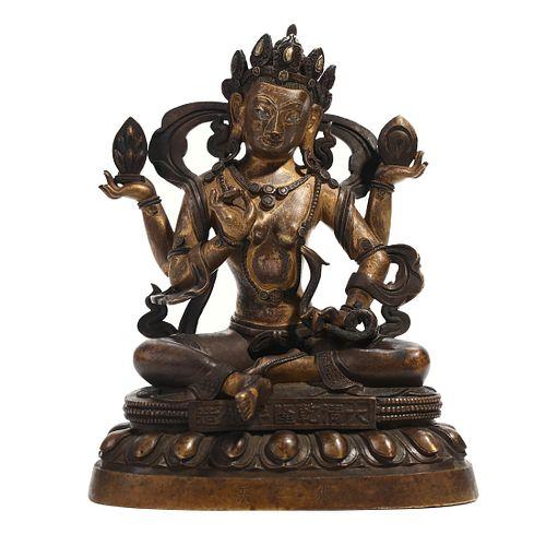 A BRONZE FOUR-ARMED BUDDHA FIGURE