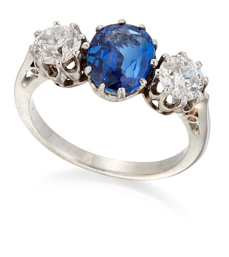 A SAPPHIRE AND DIAMOND THREE STONE RING, a cushion-cut sapphire between old