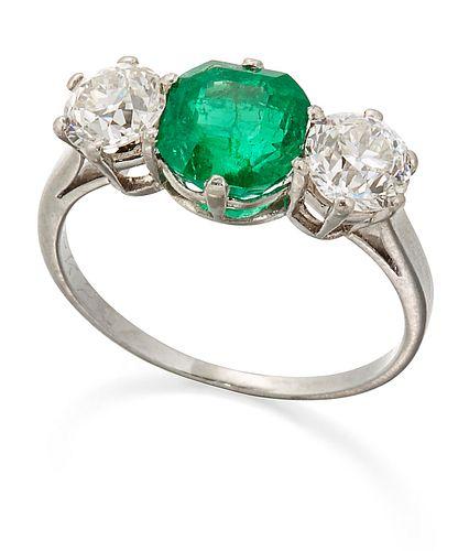AN EMERALD AND DIAMOND THREE STONE RING, an octagonal-cut emerald between o