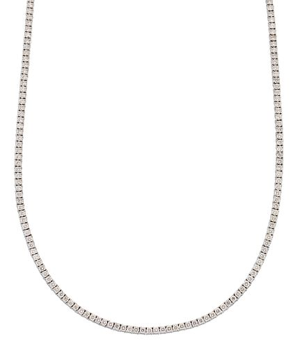 A DIAMOND LINE NECKLACE, round brilliant-cut diamonds in claw settings as a