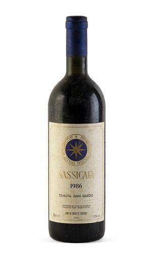 A bottle of Sassicaia Tenuta San Guido, vintage 1986. Category: red wine. D.O.C. Bolgheri Sassicaia, Italy. Level: B. 750 ml.