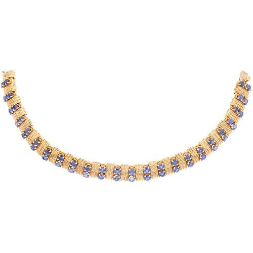 PULSERA CON ZAFIROS EN ORO AMARILLO DE 18K DE LA FIRMA MAUBOUSSIN  con zafiros corte redondo ~5.76 ct.  Peso: 43.4 g | BRACELET WITH SAPPHIRES IN 18K