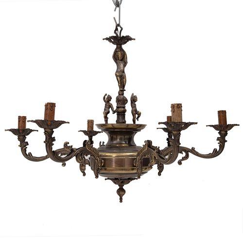 Lámpara de techo. SXX. Elaborada en metal dorado. Para 6 luces. Decorado con amorcillos, motivos florales, vegetales.