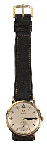 14 Karat Gold Omega Vintage Mens Watch, having leather band.