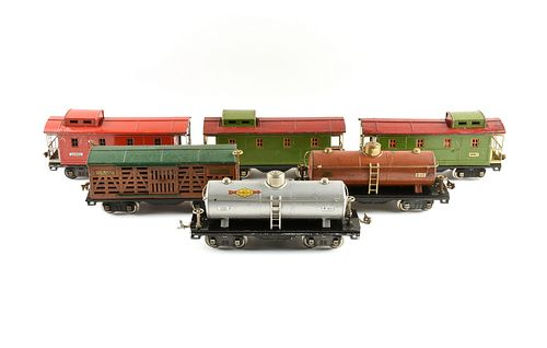 A GROUP OF LIONEL TRAIN TRACK SEGMENTS, SWITCHES, CAR TURNTABLE, AND CARS, PRE AND POST WORLD WAR II,