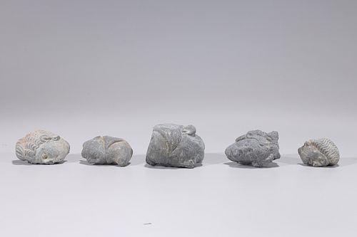 Group of Five Carved Gandharan Schist Heads