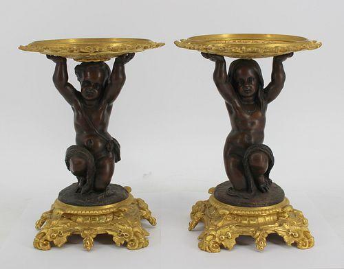 An Antique Pair Of Patinated & Gilt Bronze