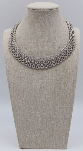 JEWELRY. 5 Cttw Diamond and 18kt Gold Necklace.