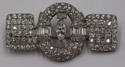 JEWELRY. 5+ Cttw Diamond and Platinum Brooch.