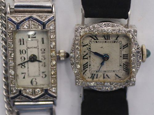 JEWELRY. (2) Lady's Platinum and diamond Watches.
