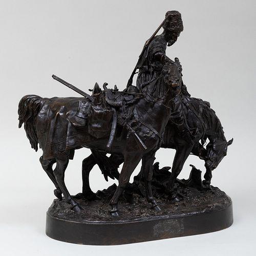 After Evgeni Lanceray (1875-1946): A Bronze Group of a Cossack After Battle