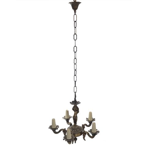"Candil. Italia, sXX. Elaborado en bronce. Para 5 luces. Arandelas vegetales, brazos en ""S"". Decorado con motivos orgánicos. 40 cm alt."