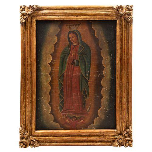ANÓNIMO. Virgen de Guadalupe. Óleo sobre tela. 107 x 75 cm. Enmarcado.