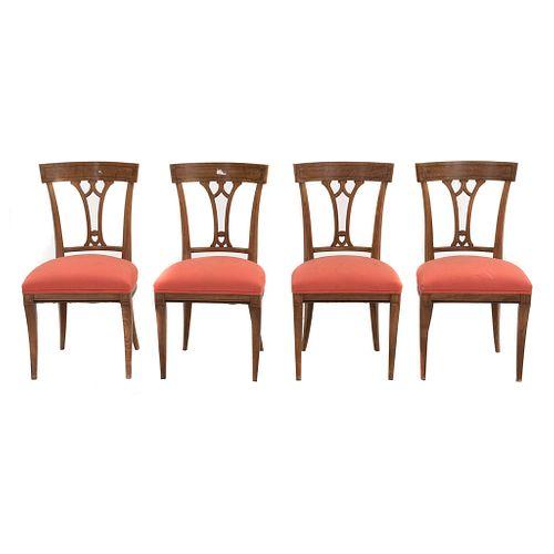 Lote de 4 sillas. SXX. Elaboradas en madera. Con respaldos calados, asientos acojinados  soportes tipo sable. Decoradas con molduras.