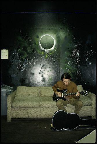 JJ Gonson, A91 - Elliott Smith, tuning backstage in LA, cir 1994
