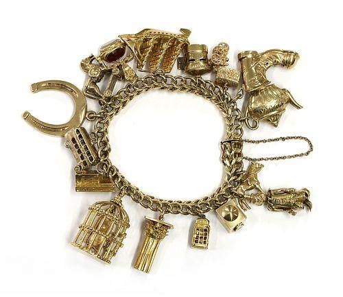 A gold charm bracelet,