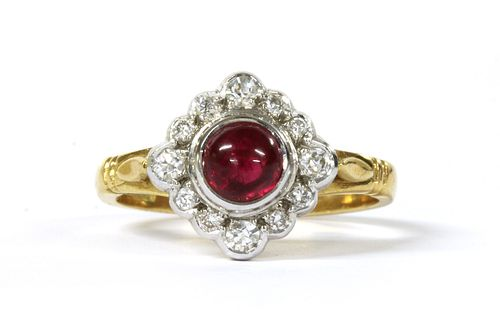 An 18ct gold ruby and diamond off set square cluster ring,
