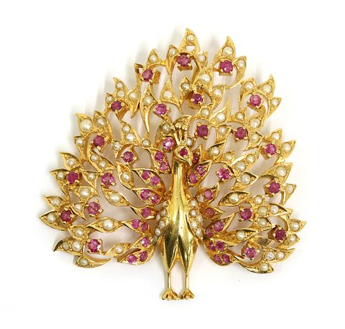 A gold ruby and split pearl peacock pendant,