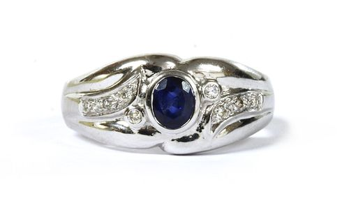 A white gold sapphire and diamond ring,