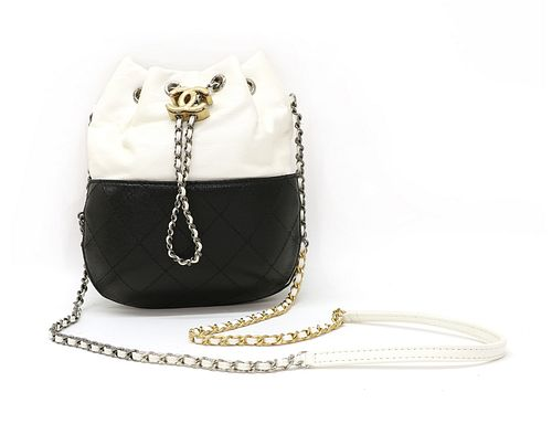 A Chanel Gabrielle two-tone black and white leather bucket bag,