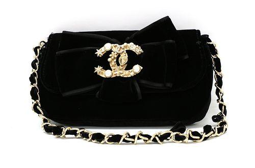 A Chanel black velvet evening bag,