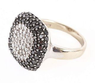 A Lady's White and Black Diamond Ring