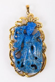 A Gold Lapis Carved Pendant