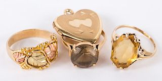 Three Rings and a Gold Heart Locket