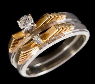 An 18 Karat Two-Tone Diamond Wedding Set