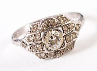 An 18 Karat White Gold Diamond Filigree Ring
